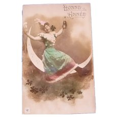 Lovely New Years Real Photo French Postcard of a Maiden Sitting on the moon