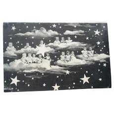 vintage French Real Photo Multiple Baby Postcard on Clouds in the Night Sky