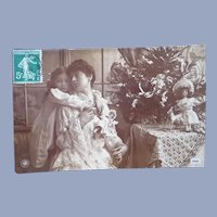 Vintage French Real Photo Christmas Postcard of Mother and Child with Toys