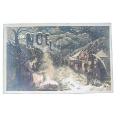 Vintage Real Photo French Christmas Postcard of family around a fire in the Snow
