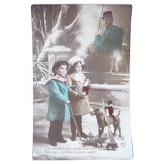 Vintage French Real Photo Postcard of Children with Toys and Image of Soldier