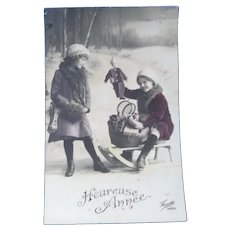 Vintage Real Photo French New Year's Postcard of Children and Doll