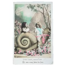 Vintage Real Photo New Years French Postcard of Children Playing with Snail