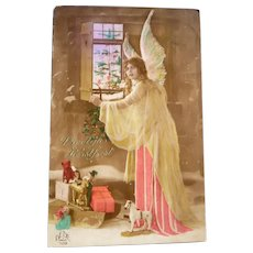 Vintage Real Photo German Postcard of Angel and Presents