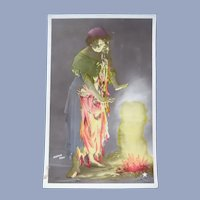Vintage real Photo French Postcard of a Gypsy Warming her Hands over a Fire