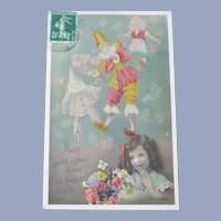 Lovely Vintage French Real Photo Postcard of a Girl Dreaming of Dolls