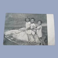 Vintage Real Photo Surreal Postcard of Children Riding a Fish