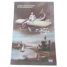 Vintage Real Photo French Postcard of Baby riding a Fish Plane over a countryside
