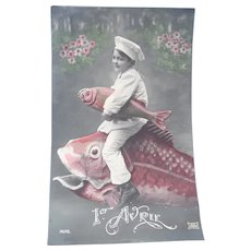 Vintage Real photo April Fool's Postcard of Child Chef riding on the back of a fish