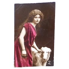 Vintage Real Photo 1908 French Postcard of Elegant lady and her prised Dog.