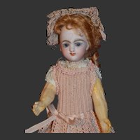 Adorable tiny EDEN BEBE Paris with gorgeous antique dress and hat.