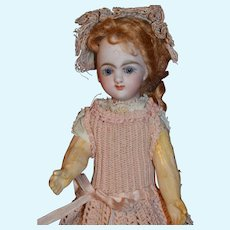 Adorable tiny EDEN BEBE Paris with gorgeous antique dress and hat.