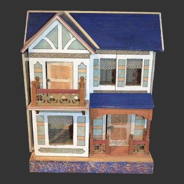 Wooden two-story dollhouse well-furnished for the French market
