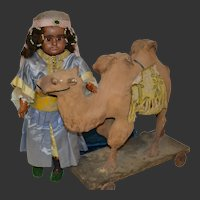 French doll with her camel in superb exhibition costume
