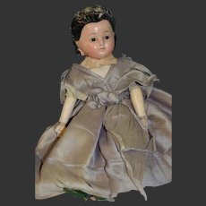 Circa 1860 early pumpkin doll with dark brown hair