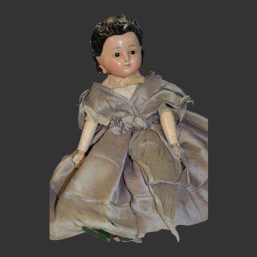 Circa 1860 early pumpkin doll with dark brown hair