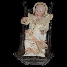 Darling set the  baby from Brittany and it carved Brittany cradle,