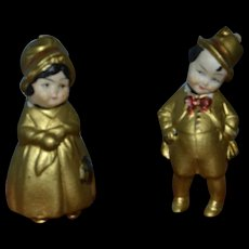 All bisque dolls with lovely molded gold clothes