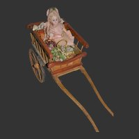 Rare 1890 toys for the French market Little girl in a cart coming from the fair
