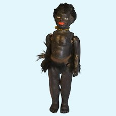 Rare composition black little doll 1900