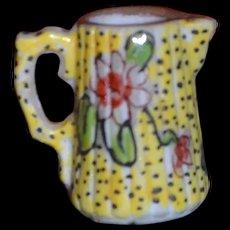 Little porcelain pot with a tea pot mark