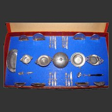 All original miniature German dinner set in pewter sell by le nain bleu