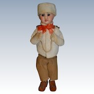 Sweet French candy container in winter costume like snow baby