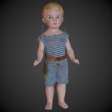 Lovely Antique bathing doll damaged