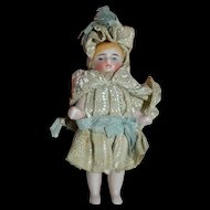 Lovely tiny all bisque doll witha fabulous 1880 costume