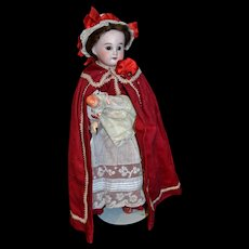 Antique French doll in nurse costume 1900