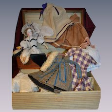French fashion doll probably barrois with her trunk and  1865 trousseau
