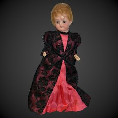 Little german doll with a lovely vintage costume