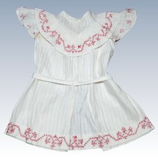 Charming apron dress  made by a child