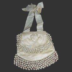 First communion souvenir , cream satin purse 1880