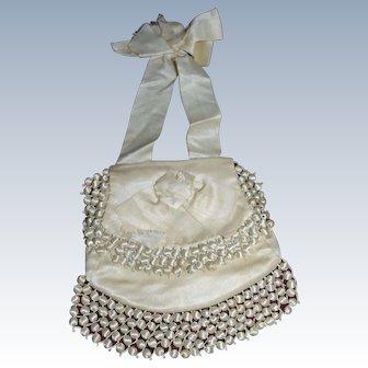 First communion souvenir , cream satin purse 1880