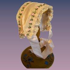 Lovely doll's bonnet circa1900 in pink silk