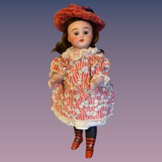 Famous Simon and Halbig big all bisque doll with 4 straps shoes