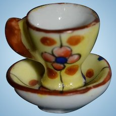 Tiny flowered cup for your doll's house