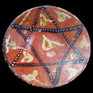 Rare Islamic pottery dish with star decoration, 11th. century AD