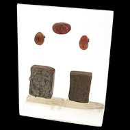 An old collection of 4 ancient stamp seals on a plexi stand!