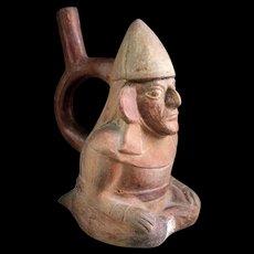 Rare Moche Head Stirrup vessel with seated Warrior, 200-500 AD