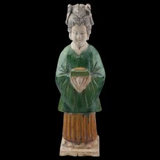 Exceptional Chinese pottery figure of a female attendant, Ming Dynasty