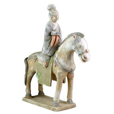 Scarce Chinese Ming Dynasty pottery lady horse rider, 1368-1644