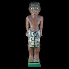 Rare large Egyptian wooden figure of a standing male, 2030-1640 BC