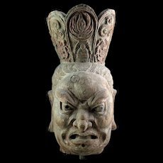 Massive Chinese sculptural wooden head of a Guardian, ca. 17th. cent.