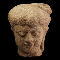 Important near lifesize Stone head of Majahapit Kingdom, 14th. cent.