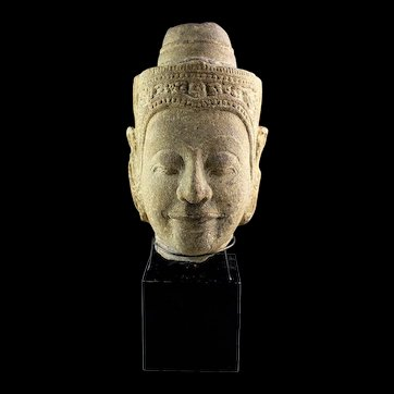 Rare and important large Sukhothai sandstone head of Buddha