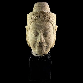 Rare and important large Sukhothai sandstone head of Buddha