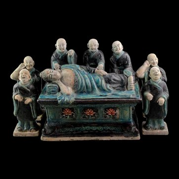 Important Ming Blue glaced Tomb pottery group of the Dying Buddha and Acolytes