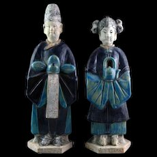 Choice pair of glazed Chinese pottery attendants, Ming Dynasty